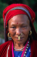 This RYE woman is wearing GOLD JEWELRY  in her nose & ears - EASTERN, NEPAL