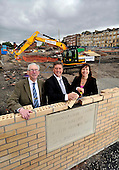 This image is free to use - Keith Brown  Minister for Housing and Transport  lays the foundation stone of the major new Affordable housing development under construction for Queens Cross Housing Association at Oban Drive  Glasgow. With Mr Brown at the £14.28m 128 home site (formerly the North Kelvinside School) for the ceremony were John Gray (Chairman Queens Cross Housing Association