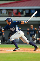 Travis Flores (20) of the Princeton Rays follows through on his swing against the Burlington Royals at Burlington Athletic Park on July 5, 2013 in Burlington, North Carolina.  The Royals defeated the Rays 5-1 in game one of a doubleheader.  (Brian Westerholt/Four Seam Images)