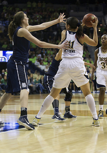 March 04, 2013:  Notre Dame forward Natalie Achonwa (11) looks to pass the ball as Connecticut forward Breanna Stewart (30) defends during NCAA Basketball game action between the Notre Dame Fighting Irish and the Connecticut Huskies at Purcell Pavilion at the Joyce Center in South Bend, Indiana.  Notre Dame defeated Connecticut 96-87 in triple overtime.