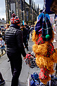 """Edinburgh, UK. 15.04.2017. A man in a Union Flag decorated wolly hat passes a shop selling ginger """"Jimmy"""" hats, on the Royal Mile. Photograph © Jane Hobson."""