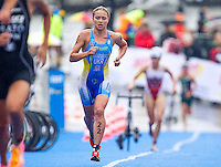 26 AUG 2012 - STOCKHOLM, SWE - Yuliya Yelistratova (UKR) of Ukraine heads through transition for the start of her run leg during the 2012 ITU Mixed Relay Triathlon World Championships in Gamla Stan, Stockholm, Sweden (PHOTO (C) 2012 NIGEL FARROW)
