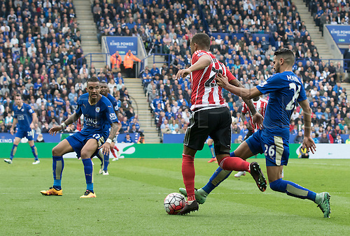 03.04.2016. King Power Stadium, Leicester, England. Barclays Premier League. Leicester versus Southampton.  Leicester City midfielder Riyad Mahrez comes in to tackle Southampton defender Ryan Bertrand for the ball.