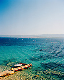 CROATIA, Bol, Brac, Dalmatian Coast, Island, elevated view of Dalmatian coast and windsurfers in the background.
