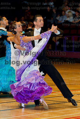 Kota Shoji and Nami Shoji from Japan perform their dance during the professional ballroom competition of the International Championships held in Brentwood Leasure Centre in Brentwood, United Kingdom on October 12, 2011. ATTILA VOLGYI