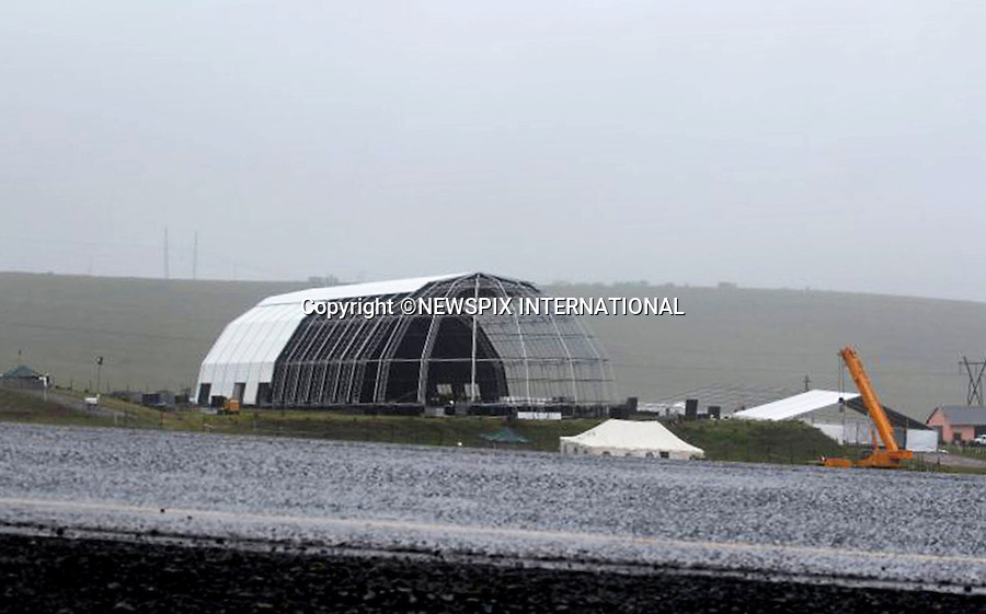 Qunu, South Africa: 11.12.2013: NELSON MANDELA FUNERAL<br /> Work in progress to construct the arena for Nelson Madela's Funeral on Sunday 1th December 2013.<br /> Haevy rain has hampered the progress.<br /> Mandatory Credit Photo: &copy;NEWSPIX INTERNATIONAL<br /> <br /> **ALL FEES PAYABLE TO: &quot;NEWSPIX INTERNATIONAL&quot;**<br /> <br /> IMMEDIATE CONFIRMATION OF USAGE REQUIRED:<br /> Newspix International, 31 Chinnery Hill, Bishop's Stortford, ENGLAND CM23 3PS<br /> Tel:+441279 324672  ; Fax: +441279656877<br /> Mobile:  07775681153<br /> e-mail: info@newspixinternational.co.uk