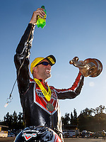 Nov 13, 2016; Pomona, CA, USA; NHRA pro stock motorcycle rider Matt Smith celebrates after winning the Auto Club Finals at Auto Club Raceway at Pomona. Mandatory Credit: Mark J. Rebilas-USA TODAY Sports
