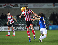 Lincoln City's Michael O'Connor vies for possession with Exeter City's Matt Jay<br /> <br /> Photographer Andrew Vaughan/CameraSport<br /> <br /> The EFL Sky Bet League Two - Lincoln City v Exeter City - Tuesday 26th February 2019 - Sincil Bank - Lincoln<br /> <br /> World Copyright © 2019 CameraSport. All rights reserved. 43 Linden Ave. Countesthorpe. Leicester. England. LE8 5PG - Tel: +44 (0) 116 277 4147 - admin@camerasport.com - www.camerasport.com