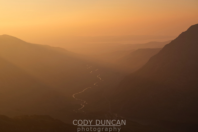 View of Ogwen valley at sunset from summit of Glyder Fach, Snowdonia national park, Wales, Ogwen valley, silhouette, river, view, sunset, haze, hazy, colourful. colorful, above, view, viewpoint,