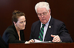 Nevada Assembly Speaker John Hambrick, R-Las Vegas, talks with Chief Clerk Susan Furlong on the Assembly floor at the Legislative Building in Carson City, Nev., on Friday, Feb. 13, 2015.   <br /> Photo by Cathleen Allison