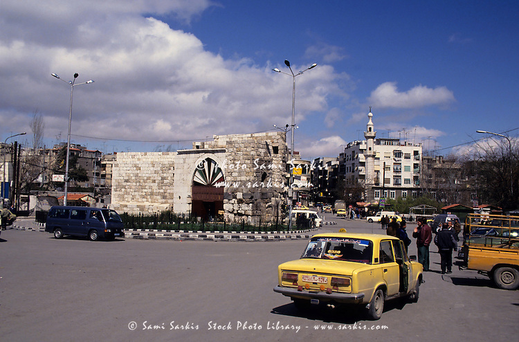 Traffic at a roundabout of Bab Tuma, a borough in the old city of Damascus, Syria.