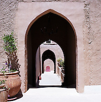 An enfilade through a series of arches leads to a fountain
