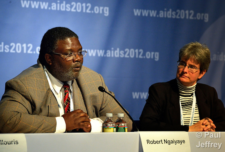Robert Ngaiyaye (left) of the Malawi Interfaith AIDS Association speaks at a July 25, 2012, press conference announcing the results of a 2012 pilot dialogue in Malawi between religious leaders, faith-based organizations and networks of people living with HIV. The discussion was the first of its kind and represented a breakthrough for dialogue and joint advocacy in Malawi. On the right is Sara Speicher, the communications coordinator for the Ecumenical Advocacy Alliance. (Photo Paul Jeffrey/EAA.)