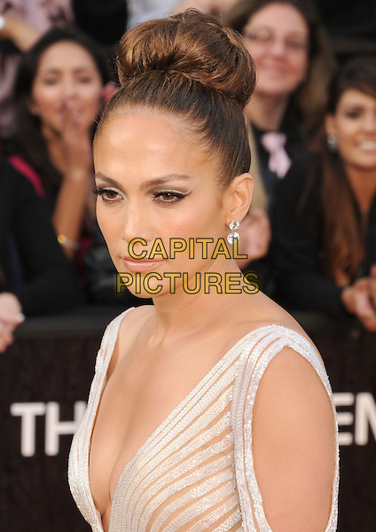 Jennifer Lopez.Arrivals to the 84th Annual Academy Awards held at The Theatre at Hollywood & Highland Centre in Hollywood, California, USA. .February 26th, 2012.oscars headshot portrait striped stripes cut out sleeves low cut neckline cleavage hair up bun.CAP/ROT/TM.©Tony Michaels/Roth Stock/Capital Pictures
