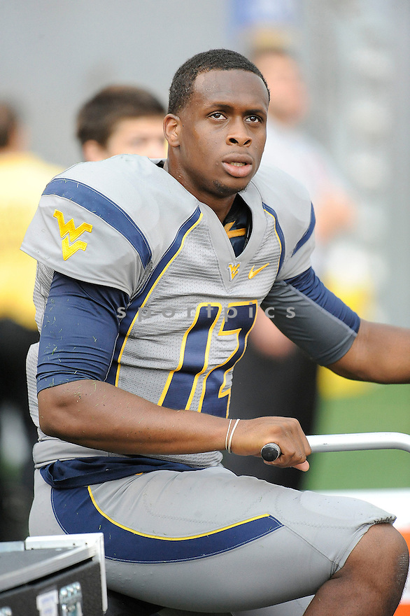 West Virginia Mountaineers Geno Smith (12) in action during a game against the Maryland Terrapins on September 22, 2012 at Milan Puskar Stadium in Morgantown, WV. West Virginia beat Maryland 31-21.