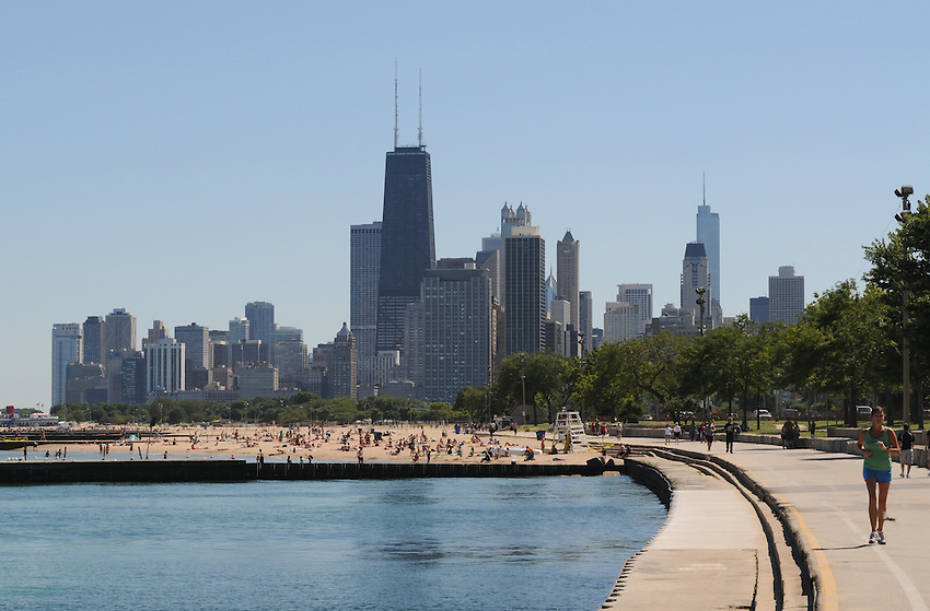 Along Chicago's Lakefront Trail, across from Lincoln Park, the sandy shores and lapping waters of Lake Michigan are the perfect prescription for a hot sunny summer day.