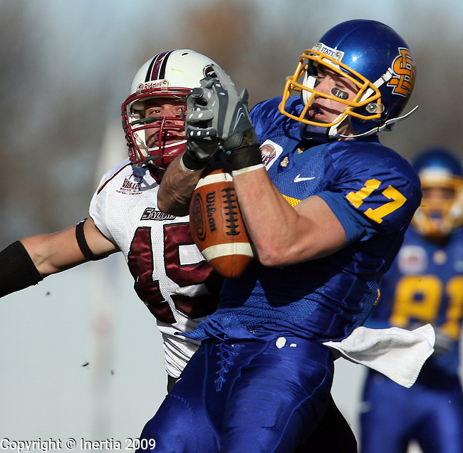 BROOKINGS, SD - NOVEMBER 7:  Glen Fox #17 of South Dakota State University has the ball slip through his hands while being defended by Connor James #45 of Southern Illinois in the second quarter of their Missouri Valley Conference game Saturday afternoon at Coughlin Alumni Stadium in Brookings. (Photo by Dave Eggen/Inertia).