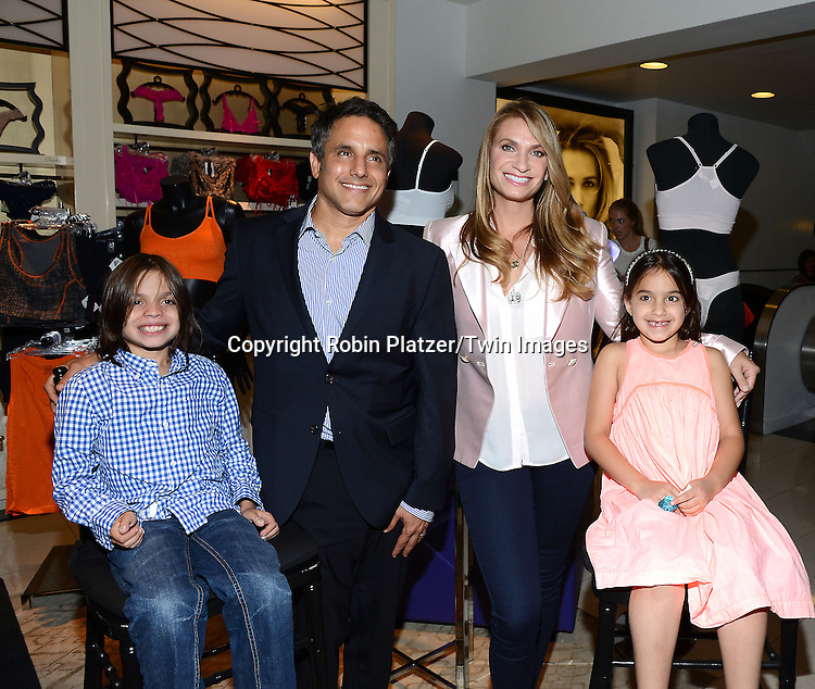 Heather Thomsonand her family, son Jax, husband Jon Schindler, and daughter Ella  introduces her new denim and acitve collections called Yummie  by Heather Thomson at Bloomingdales in New York City on September 11, 2014.<br /> <br /> photo by Robin Platzer/Twin Images<br />  <br /> phone number 212-935-0770