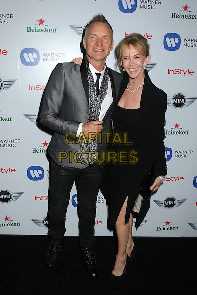 Sting (Gordon Sumner) & Trudie Styler.Warner Music Group 2013 Grammy Celebration held at The Chateau Marmont, West Hollywood, California, USA..February 10th, 2013.full length suit jacket dress married husband wife coat black grey gray shirt white pattern scarf   .CAP/ADM/BP.©Byron Purvis/AdMedia/Capital Pictures.