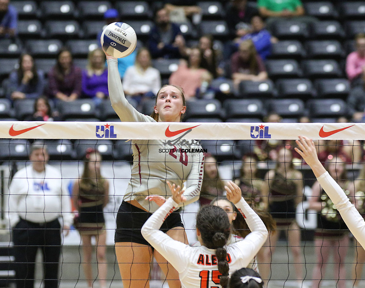 Rouse Raiders senior Ava Bell (20) attacks during a Class 5A girls high school semifinal volleyball game between Rouse High School and Aledo High School at Curtis Culwell Center in Garland, Texas, on November 17, 2017. Rouse swept Aledo (25-17, 27-25, 25-18) to advance to the finals.