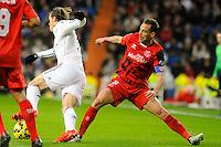 Real Madrid´s Gareth Bale and Sevilla's Fernando Navarro during 2014-15 La Liga match between Real Madrid and Sevilla at Santiago Bernabeu stadium in Alcorcon, Madrid, Spain. February 04, 2015. (ALTERPHOTOS/Luis Fernandez) /NORTEphoto.com
