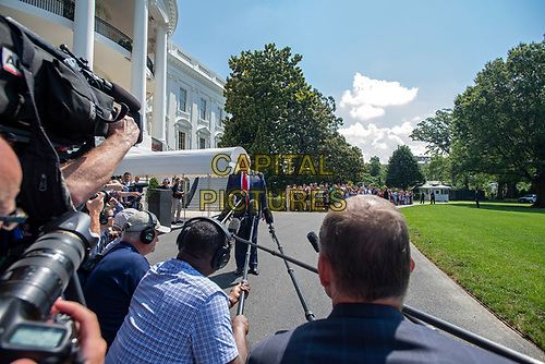 United States President Donald J. Trump makes remarks and answers reporter's questions as he prepares to depart the South Lawn of the White House in Washington, DC on Friday, July 5, 2019.  The President will travel to Westminster, New Jersey for the weekend.<br /> CAP/MPI/RS<br /> ©RS/MPI/Capital Pictures