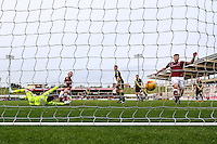 John-Joe O'Toole of Northampton Town (2nd left) scores his team's second goal against Morecambe to make it 2-0 during the Sky Bet League 2 match between Northampton Town and Morecambe at Sixfields Stadium, Northampton, England on 23 January 2016. Photo by David Horn / PRiME Media Images.