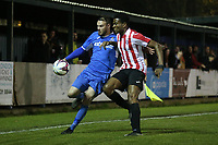 Martin Tuohy of Redbridge and Youseuf Bello of Clapton during Redbridge vs Clapton, Essex Senior League Football at Oakside Stadium on 14th November 2017