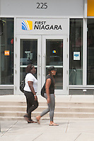 Two women walk by a branch of First Niagara bank in Hartford, Connecticut, Saturday August 6, 2011. First Niagara Bank (NASDAQ: FNFG) is a Federal Deposit Insurance Corporation-insured regional banking corporation.