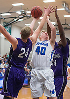 NWA Democrat-Gazette/BEN GOFF @NWABENGOFF<br /> Jaden Uecker (40) of Rogers makes a basket as Hank Gibbs (24) and Tamaury Releford (44) of Fayetteville defend Friday, Feb. 9, 2018, in King Arena at Rogers High.