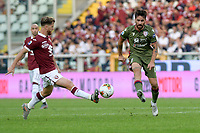 27th October 2019; Olympic Grande Torino Stadium, Turin, Piedmont, Italy; Serie A Football, Torino versus Cagliari; Cristian Ansaldi of Torino FC challenges Luca Cigarini of Cagliari - Editorial Use