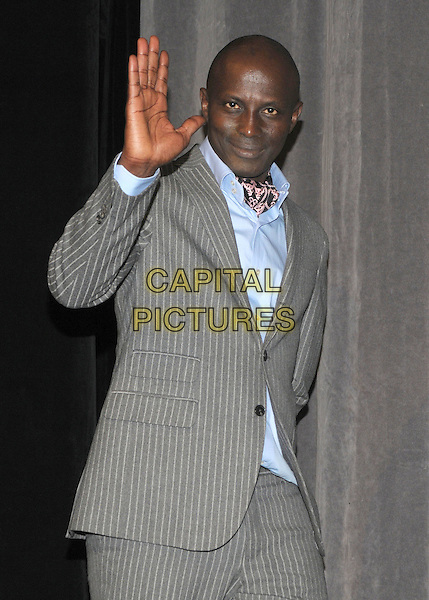 "Souleymane Sy Savane .""Machine Gun Preacher"" Premiere - 2011 Toronto International Film Festival held at Roy Thomson Hall, Toronto, Ontario, Canada..September 11th, 2011.half length grey gray suit blue shirt hand arm waving pinstripe .CAP/ADM/BPC.©Brent Perniac/AdMedia/Capital Pictures."