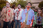 "Oct. 30, 2009 -- PHOENIX, AZ: Zombies gather in downtown Phoenix Friday evening. About 200 people participated in the first ""Zombie Walk"" in Phoenix, AZ, Friday night. The Zombies walked through downtown Phoenix ""attacking"" willing victims and mixing with folks going to the theatre and downtown sports venues.  Photo by Jack Kurtz"