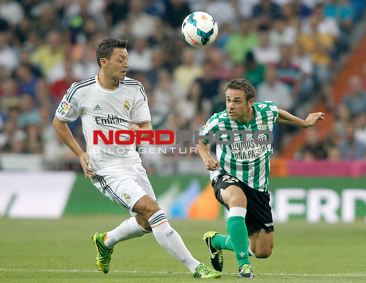 Real Madrid's Mesut Ozil (l) and Betis' Nacho Perez during La Liga match.August 18,2013. Foto © nph / Acero)