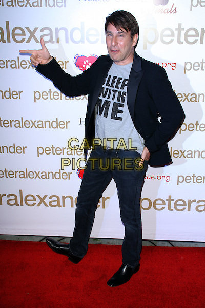 PETER ALEXANDER.Peter Alexander Flagship Boutique Grand Opening held at the Peter Alexander Boutique, Los Angeles, California, USA..October 22nd, 2008.full length grey gray top t-shirt sleep with me slogan black jacket jeans denim hand pointing .CAP/ADM/FS.©Faye Sadou/AdMedia/Capital Pictures.