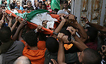 Relatives and friends carry the body of Palestinian Bashir Abdel Aal, 20,in Rafah in the southern Gaza Strip, following an Israeli air strike before a five-hour truce went into effect on July 17, 2014 Israeli shelling killed four Palestinian boys on a Gaza beach on Wednesday, an incident the military called tragic, and Israel and Hamas said they would cease attacks for five hours on Thursday for a humanitarian truce requested by the United Nations. Palestinian militants fired more than 130 rockets into Israel on the ninth day of a war in which Israeli attacks have killed 231 Palestinians, including six in two air strikes on Wednesday. Most of the casualties were civilians, health officials in Gaza said. In Israel, a civilian has been killed by one of more than 1,000 Palestinian rockets fired and more than half a dozen people have been wounded. Photo by Eyad Al Baba