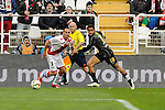 Rayo Vallecano´s Jose Ignacio Garcia and Malaga CF´s Roberto Jose Rosales during 2014-15 La Liga match between Rayo Vallecano and Malaga CF at Rayo Vallecano stadium in Madrid, Spain. March 21, 2015. (ALTERPHOTOS/Luis Fernandez)
