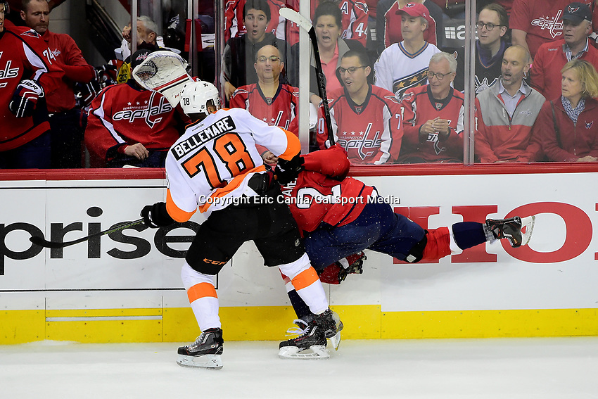 Friday, April 22, 2016: Philadelphia Flyers right wing Pierre-Edouard Bellemare (78) checks Washington Capitals defenseman Matt Niskanen (2) as goalie Philipp Grubauer (31) protects his face with his glove during game 5 of the first round of the National Hockey League Eastern Conference playoffs  between the Philadelphia Flyers and the Washington Capitals held at the Verizon Center in Washington, DC. The Flyers defeat the Capitals 2-0. Eric Canha/CSM