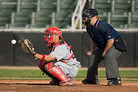 Jesus Sanchez (33) of the Lakewood BlueClaws catches a pitch as home plate umpire Matthew Pridemore looks on at Fieldcrest Cannon Stadium in Kannapolis, NC, Sunday, May 11, 2008.