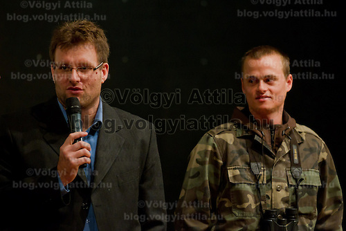 Zsolt Marcell Toth (L) nature movie director attends a press conference where nature photographer Bence Mate (R) from Hungary presents the documentary showing his work in Budapest, Hungary on December 12, 2011. ATTILA VOLGYI