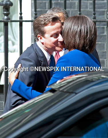 """The Obamas visit the Camerons at number 10 Downing Street_24/05/2011.Mandatory Photo Credit: ©Dias/Newspix International..**ALL FEES PAYABLE TO: """"NEWSPIX INTERNATIONAL""""**..PHOTO CREDIT MANDATORY!!: NEWSPIX INTERNATIONAL(Failure to credit will incur a surcharge of 100% of reproduction fees)..IMMEDIATE CONFIRMATION OF USAGE REQUIRED:.Newspix International, 31 Chinnery Hill, Bishop's Stortford, ENGLAND CM23 3PS.Tel:+441279 324672  ; Fax: +441279656877.Mobile:  0777568 1153.e-mail: info@newspixinternational.co.uk"""