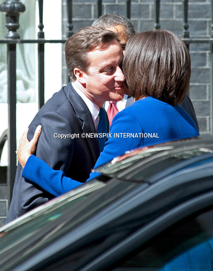 "The Obamas visit the Camerons at number 10 Downing Street_24/05/2011.Mandatory Photo Credit: ©Dias/Newspix International..**ALL FEES PAYABLE TO: ""NEWSPIX INTERNATIONAL""**..PHOTO CREDIT MANDATORY!!: NEWSPIX INTERNATIONAL(Failure to credit will incur a surcharge of 100% of reproduction fees)..IMMEDIATE CONFIRMATION OF USAGE REQUIRED:.Newspix International, 31 Chinnery Hill, Bishop's Stortford, ENGLAND CM23 3PS.Tel:+441279 324672  ; Fax: +441279656877.Mobile:  0777568 1153.e-mail: info@newspixinternational.co.uk"