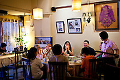 Customers share a light moment with friends and family at the Mama's restaurant in capital Georgetown of Penang, Malaysia. Photo: Sanjit Das/Panos