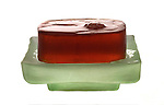 bar of glycerin soap on soap dish on shadowless white background