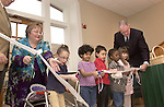 Children enrolled in the Ohio University Child Development Center cut a ribbon at an open house for the facility Friday.  Child Development Center Administrator Cathy Waller (left) and Ohio University President Robert Glidden (right) assist the children. The center is located in the renovated horse barn at The Ridges.