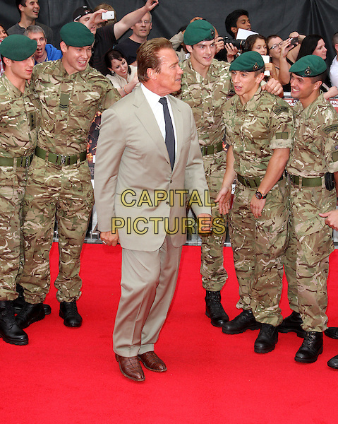 Arnold Schwarzenegger.'The Expendables 2' UK film premiere held at the Empire Leicester Square,.London, England..13th August 2012.full length beige suit jacket black tie profile white shirt army green camouflage hat .CAP/ROS.©Steve Ross/Capital Pictures.