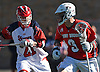 Ryan Bitzer #9 of Stony Brook, right, gets pressured by Brian Gaffney #21 of St. John's University during an NCAA Division I men's lacrosse game at DaSilva Memorial Field on Sunday, Feb. 19, 2017. Bitzer tallied a goal and five assists as Stony Brook rallied from an early 4-0 deficit to win 14-5.