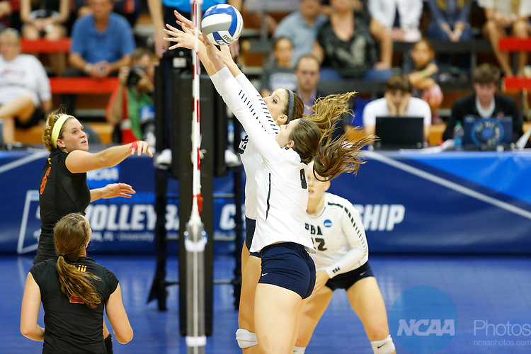 12 DEC 2015:  Palm Beach Atlantic University players attempt a block against Wheeling Jesuit University during the Division II Women's Volleyball Championship is held at the Martinez Athletic Center on the University of Tampa campus in Tampa, FL.  The Wheeling Jesuit University Cardinals defeated the Palm Beach Atlantic University Sailfish 3-0 for the national title.  Matt Marriott/NCAA Photos