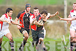 Eamon McGuire Killarney is tackled by Gary O'Sullivan UCC during their cup game in Killarney on Sunday
