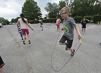 NWA Democrat-Gazette/FLIP PUTTHOFF <br />FITNESS CHALLENGE<br />Xzavier Mann (cq), 9, jumps rope Wednesday May 10 2017 during the Nestle Boys & Girls Club Fitness Challenge held at Benton County Boys & Girls Club in Bentonville. Kids took part in several fitness events, including jump rope, push ups, basketball and sit ups. The fitness challenge is a national event at 750 Boys & Girls Clubs that involves about 75,000 youngsters, said Ginger Brooks with Nestle USA.